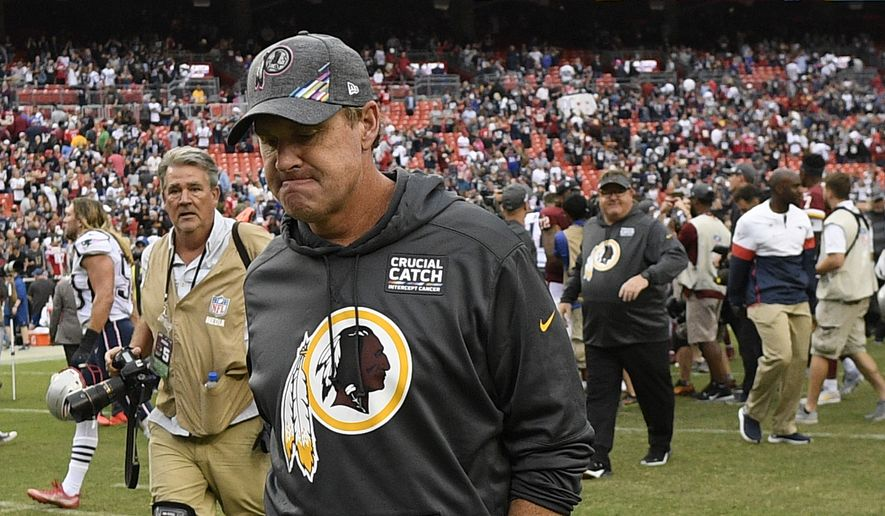 Washington Redskins head coach Jay Gruden leaves the field after an NFL football gameagainst the New England Patriots, Sunday, Oct. 6, 2019, in Washington. The New England Patriots won 33-7. (AP Photo/Nick Wass)
