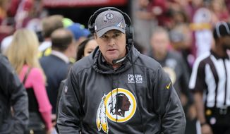 Washington Redskins head coach Jay Gruden walks to the bench prior to an NFL football game against the New England Patriots, Sunday, Oct. 6, 2019, in Landover, Md. (AP Photo/Mark Tenally)  **FILE**