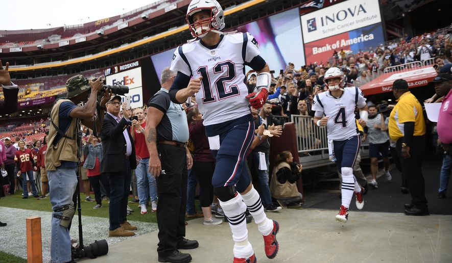 New England Patriots quarterback Tom Brady (12) takes the field ahead of an NFL football game between the Washington Redskins and the New England Patriots, Sunday, Oct. 6, 2019, in Washington. (AP Photo/Nick Wass)