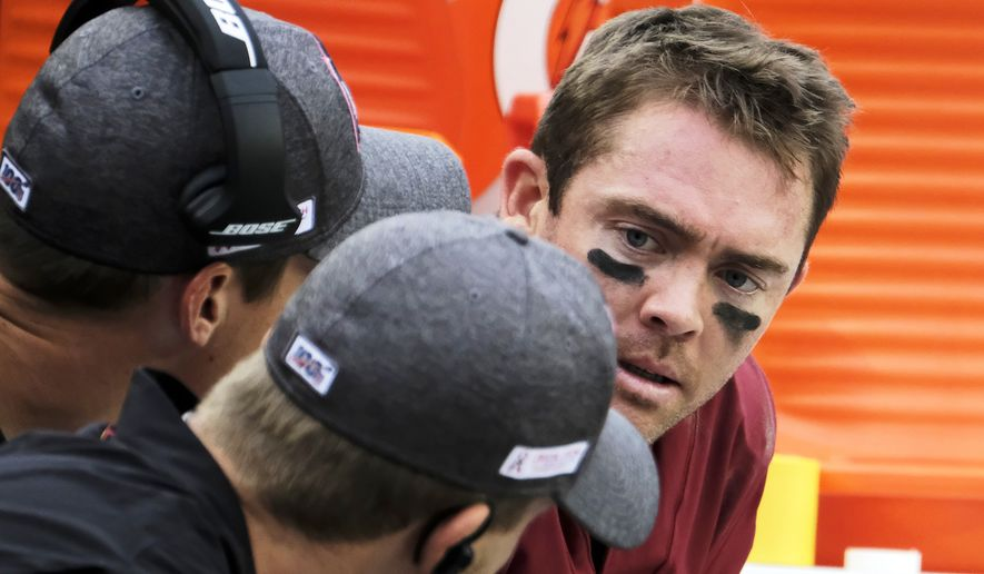 Washington Redskins quarterback Colt McCoy (right) sits on the bench during an NFL football game against the New England Patriots, Sunday, Oct. 6, 2019, in Landover, Md. (AP Photo/Mark Tenally)