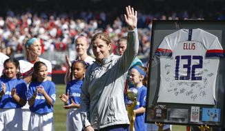 United States head coach Jill Ellis waves to the crowd as she is honored during a ceremony before an international friendly soccer match against South Korea, Sunday, Oct. 6, 2019, in Chicago. (AP Photo/Kamil Krzaczynski)