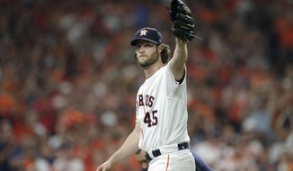Houston Astros starting pitcher Gerrit Cole waves to fans as he leaves during the eighth inning of Game 2 of the baseball team's American League Division Series against the Tampa Bay Rays in Houston, Saturday, Oct. 5, 2019. (AP Photo/Michael Wyke)