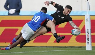 New Zealand's T J Perenara looks to score a try as he is tackled by Namibia's Helarius Kisting during the Rugby World Cup Pool B game at Tokyo Stadium between New Zealand and Namibia in Tokyo, Japan, Sunday, Oct. 6, 2019. The All Blacks defeated Namibia 71-9. (AP Photo/Christophe Ena)