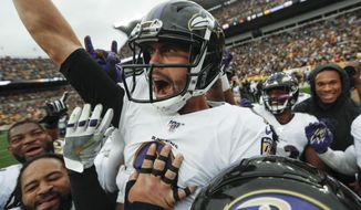 Baltimore Ravens kicker Justin Tucker (9) and Sam Koch (4) celebrates with teammates after he made a field goal to defeat the Pittsburgh Steelers in overtime of an NFL football game, Sunday, Oct. 6, 2019, in Pittsburgh. The Ravens won 26-23. (AP Photo/Don Wright)