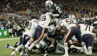 Oakland Raiders running back Josh Jacobs (28) goes in for a touchdown during the second half of an NFL football game against the Chicago Bears at Tottenham Hotspur Stadium, Sunday, Oct. 6, 2019, in London. (AP Photo/Tim Ireland)