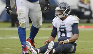Tennessee Titans quarterback Marcus Mariota (8) sits on the turf after a play against the Buffalo Bills in the second half of an NFL football game Sunday, Oct. 6, 2019, in Nashville, Tenn. (AP Photo/Mark Zaleski)