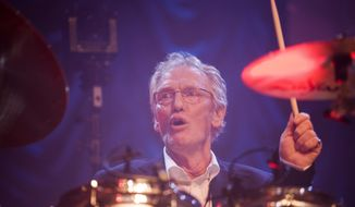 FILE - In this Sunday, Dec. 7, 2008 file photo, British musician Ginger Baker performs at the 'Zildjian Drummers Achievement Awards' at the Shepherd's Bush Empire in London. The family of drummer Ginger Baker, the volatile and propulsive British musician who was best known for his time with the power trio Cream, says he died, Sunday Oct. 6, 2019. He was 80. (AP Photo/MJ Kim, File)