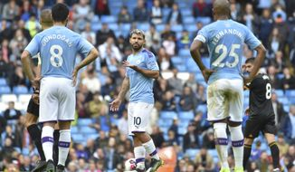 Manchester City's Sergio Aguero, center, reacts towards team mates after Wolverhampton Wanderers' Adama Traore's scored his second goal during the English Premier League soccer match between Manchester City and Wolverhampton Wanderers at Etihad stadium in Manchester, England, Sunday, Oct. 6, 2019. (AP Photo/Rui Vieira)