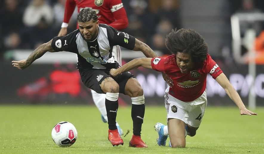 Newcastle United's DeAndre Yedlin, left, and Manchester United's Tahith Chong battle for the ball during the English Premier League soccer match at St James' Park, Newcastle, England, Sunday Oct. 6, 2019. (Owen Humphreys/PA via AP)