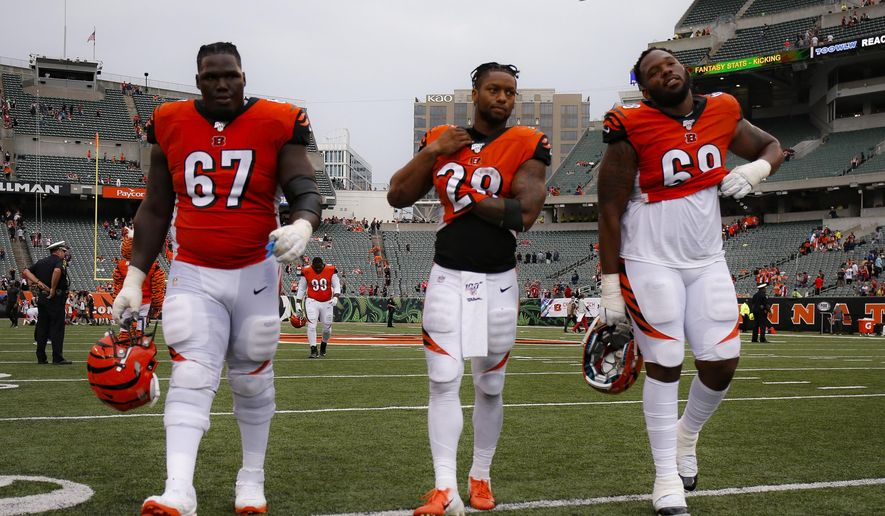 Cincinnati Bengals offensive guard John Miller (67), running back Joe Mixon (28), and offensive tackle Bobby Hart (68) walk off the field after losing an NFL football game against the Arizona Cardinals, Sunday, Oct. 6, 2019, in Cincinnati. (AP Photo/Gary Landers)