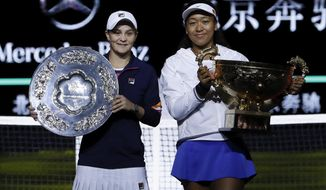 Naomi Osaka of Japan, right, and Ashleigh Barty of Australia pose with their trophies after the final of the women's singles final at the China Open tennis tournament in Beijing, Sunday, Oct. 6, 2019. Osaka defeated Barty 3-6, 6-3, 6-2. (AP Photo/Mark Schiefelbein)