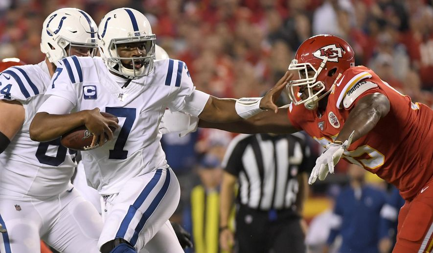 Indianapolis Colts quarterback Jacoby Brissett (7) runs away from pressure by Kansas City Chiefs defensive tackle Chris Jones, right, during the first half of an NFL football game in Kansas City, Mo., Sunday, Oct. 6, 2019. (AP Photo/Reed Hoffmann)