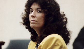 This Jan. 30, 1992 photo shows Virginia Larzelere at the Justice Center in Daytona Beach, Fla. Larzelere spent 15 years on death row before the Florida Supreme Court overturned her death sentence in 2008 on grounds that her lawyer, the late Jack Wilkins of Bartow, failed to adequately prepare her case during her trial's sentencing phase. The state's high court sent the case back to Volusia County, and lawyers there agreed to a life sentence without presenting any testimony.   (Pam Lockeby/The Daytona Beach News-Journal via AP)