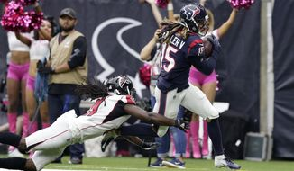 Houston Texans wide receiver Will Fuller (15) makes a catch for a touchdown asAtlanta Falcons cornerback Desmond Trufant (21) defends the play during the second half of an NFL football game Sunday, Oct. 6, 2019, in Houston. (AP Photo/Michael Wyke)