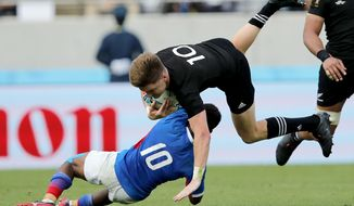 New Zealand's Jordie Barrett is tackled by Namibia's Helarius Kisting during the Rugby World Cup Pool B game at Tokyo Stadium between New Zealand and Namibia in Tokyo, Japan, Sunday, Oct. 6, 2019. (AP Photo/Christophe Ena)