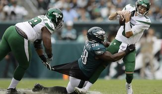Philadelphia Eagles' Hassan Ridgeway (98) tries to tackle New York Jets' Luke Falk (8) as Kelvin Beachum (68) defends during the second half of an NFL football game, Sunday, Oct. 6, 2019, in Philadelphia. (AP Photo/Matt Rourke)