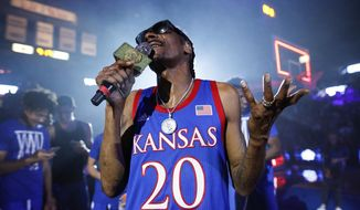In this Friday, Oct. 4, 2019, file photo, rapper Snoop Dogg performs for the Allen Fieldhouse crowd during Late Night in the Phog, Kansas' annual NCAA college basketball kickoff at Allen Fieldhouse in Lawrence, Kan. (Nick Krug/The Lawrence Journal-World via AP) ** FILE **