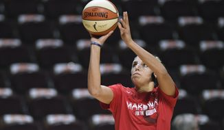 Washington Mystics' Elena Delle Donne warms up before Game 3 of basketball's WNBA Finals against the Connecticut Sun, Sunday, Oct. 6, 2019, in Uncasville, Conn. (AP Photo/Jessica Hill)