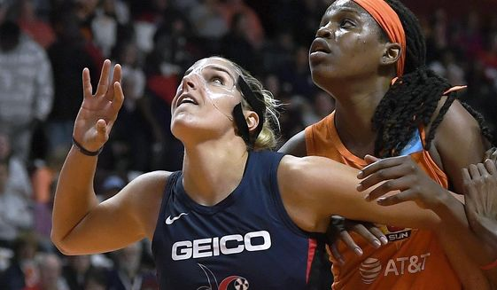Washington Mystics' Elena Delle Donne, left, and Connecticut Sun's Jonquel Jones battle for position under the basket during the first half in Game 3 of basketball's WNBA Finals, Sunday, Oct. 6, 2019, in Uncasville, Conn. (AP Photo/Jessica Hill) ** FILE **