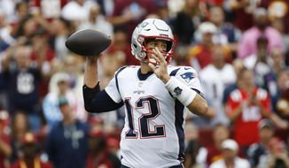 New England Patriots quarterback Tom Brady (12) works in ther pocket against the Washington Redskins during the first half of an NFL football game, Sunday, Oct. 6, 2019, in Washington. (AP Photo/Patrick Semansky)