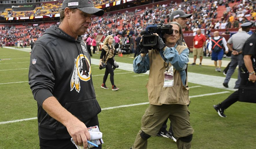 Washington Redskins head coach Jay Gruden leaves the field after an NFL football game against the New England Patriots, Sunday, Oct. 6, 2019, in Washington. The New England Patriots won 33-7. (AP Photo/Nick Wass)