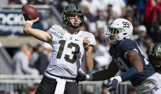 Purdue quarterback Jack Plummer (13) throws a pass while being pressured by Penn State defensive end Yetur Gross-Matos (99) in the third quarter of an NCAA college football game in State College, Pa., on Saturday, Oct. 5, 2019. Penn State defeated Purdue 35-7. (AP Photo/Barry Reeger)