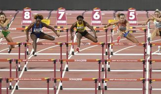 Luca Kozak, of Hungary, Nia Ali, of the United States, left, Danielle Williams, of Jamaica, Nadine Visser, of the Netherlands, and Cindy Roleder, of Germany, from left, compete in the women's 100 meter hurdles semifinal at the World Athletics Championships in Doha, Qatar, Sunday, Oct. 6, 2019. (AP Photo/Martin Meissner)