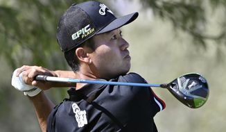 Kevin Na tees off on the third hole during the final round of Shriners Hospitals for Children Open golf tournament Sunday, Oct. 6, 2019, in Las Vegas. (AP Photo/David Becker)