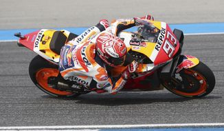 Spain's rider Marc Marquez of the Repsol Honda Team rides during final round Thailand's MotoGP at the Chang International Circuit in Buriram, Thailand, Sunday, Oct. 6, 2019. (AP Photo/Sakchai Lalit)