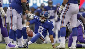 New York Giants quarterback Daniel Jones (8) is helped up off the turf after being sacked by the Minnesota Vikings during the third quarter of an NFL football game, Sunday, Oct. 6, 2019, in East Rutherford, N.J. (AP Photo/Adam Hunger)