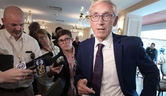 FILE - In this Sept. 24, 2019, file photo, Wisconsin Gov. Tony Evers speaks with reporters at an event in Madison, Wis. Evers plans to announce four pardons on Monday, the first issued by a Wisconsin governor in nearly nine years. Evers revived the Pardons Board this summer after his predecessor, Scott Walker, refused to issue any pardons during his eight years as governor. (AP Photo/Scott Bauer)