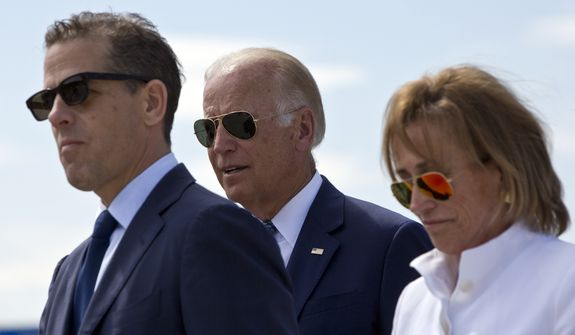 "In this file photo, family members gather for a road naming ceremony with U.S. Vice President Joe Biden, center, his son Hunter Biden, left, and his sister Valerie Biden Owens, right, joined by other family members during a ceremony to name a national road after his late son Joseph R. ""Beau"" Biden III, in the village of Sojevo, Kosovo, on Wednesday, Aug. 17, 2016. (AP Photo/Visar Kryeziu) ** FILE **"