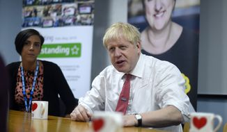 Britain's Prime Minister Boris Johnson speaks to health professionals as he visits Watford General hospital, England, Monday, Oct. 7, 2019. (Peter Summers/Pool via AP)