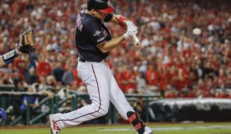Washington Nationals' Ryan Zimmerman hits a three-run home run off Los Angeles Dodgers relief pitcher Pedro Baez in the fifth inning in Game 4 of a baseball National League Division Series, Monday, Oct. 7, 2019, in Washington. (AP Photo/Alex Brandon)