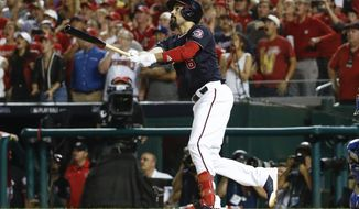 Washington Nationals' Anthony Rendon hits a sacrifice fly to left field off Los Angeles Dodgers starting pitcher Rich Hill, allowing teammate Michael A. Taylor to score, in the third inning in Game 4 of a baseball National League Division Series, Monday, Oct. 7, 2019, in Washington. (AP Photo/Patrick Semansky)