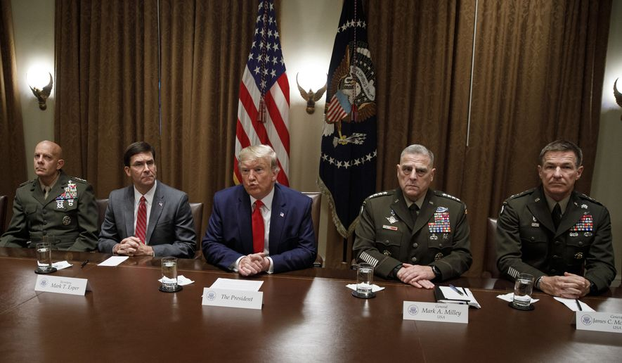 President Donald Trump, joined by from left, Gen. David Berger, Defense Secretary Mark Esper, and Chairman of the Joint Chiefs of Staff Gen. Mark Milley, and Gen. Joseph M. Martin, pauses as he speaks to media during a briefing with senior military leaders in the Cabinet Room at the White House in Washington, Monday, Oct. 7, 2019. (AP Photo/Carolyn Kaster)