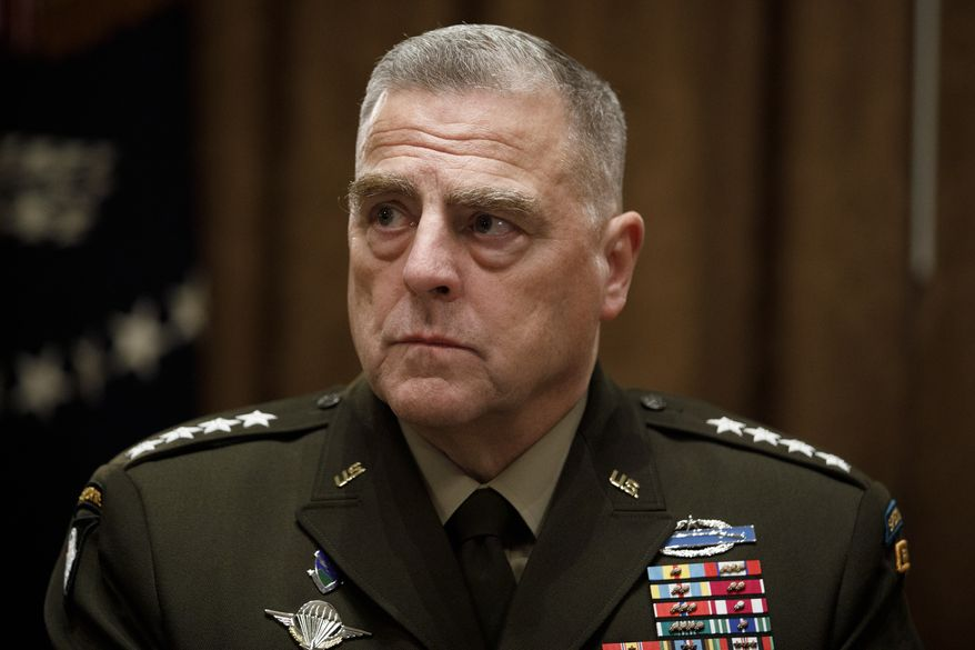 Chairman of the Joint Chiefs of Staff Gen. Mark Milley, participates in a briefing with President Donald Trump and senior military leaders in the Cabinet Room at the White House in Washington, Monday, Oct. 7, 2019. (AP Photo/Carolyn Kaster)