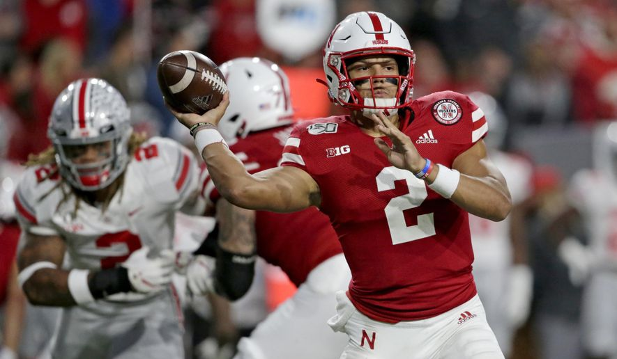FILE - In this Sept. 28, 2019, file photo, Nebraska quarterback Adrian Martinez (2) throws a pass during the first half of an NCAA college football game against Ohio State, in Lincoln, Neb. Nebraska starts the week of its trip to unbeaten Minnesota facing uncertainty about the health of two of its top players, quarterback Adrian Martinez and receiver JD Spielman. (AP Photo/Nati Harnik, File)