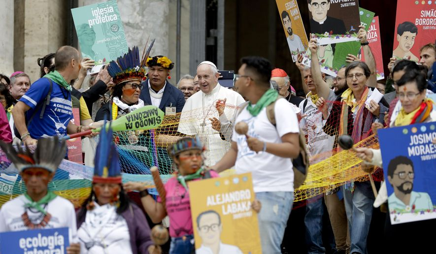 Pope Francis walks in procession on the occasion of the Amazon synod, at the Vatican, Monday, Oct. 7, 2019. Pope Francis opened a three-week meeting on preserving the rainforest and ministering to its native people as he fended off attacks from conservatives who are opposed to his ecological agenda. (AP Photo/Andrew Medichini)