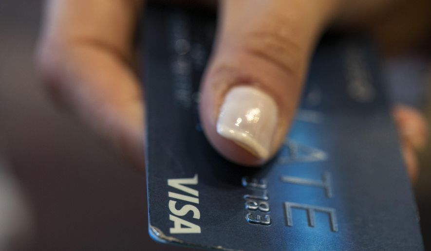 FILE - This Aug. 11, 2019, photo shows a Chase Bank Slate credit card in New Orleans. On Monday, Oct. 7, the Federal Reserve releases its August report on consumer borrowing. (AP Photo/Jenny Kane, File)