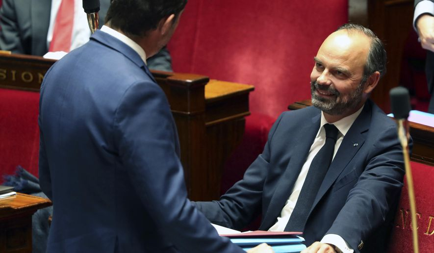 French Prime Minister Edouard Philippe smiles as he talks with French Interior Minister Christophe Castaner prior to a debate on immigration reform, at the National Assembly, in Paris, Monday, Oct. 7, 2019. Monday's debate is part of French President Emmanuel Macron's promise to confront the issue head-on during the second half of his presidency. (AP Photo/Thibault Camus)