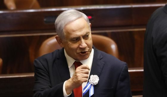 Israeli Prime Minister Benjamin Netanyahu attends the swearing-in of the new Israel's parliament in Jerusalem, Thursday., Oct. 3, 2019. (AP Photo/Ariel Schalit) ** FILE **