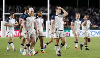 The United States team react following their Rugby World Cup Pool C game at Fukuoka Hakatanomori Stadium between France and the United States in Fukuoka, Japan, Wednesday, Oct. 2, 2019. France defeated the United States 33-9.(Jun Hirata/Kyodo News via AP)