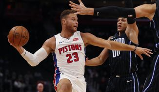 Detroit Pistons forward Blake Griffin (23) passes as Orlando Magic forward Aaron Gordon (00) defends during the first half of an NBA basketball game, Monday, Oct. 7, 2019, in Detroit. (AP Photo/Carlos Osorio)