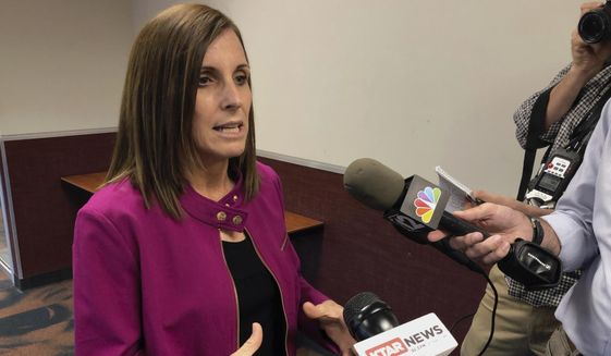 U.S. Sen. Martha McSally, R-Ariz., talks to reporters after an event in Peoria, Ariz., on Monday, Oct. 7, 2019. (AP Photo/Jonathan J. Cooper)
