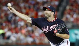 Washington Nationals starting pitcher Max Scherzer throws against the Los Angeles Dodgers during the fourth inning in Game 4 of a baseball National League Division Series, Monday, Oct. 7, 2019, in Washington. (AP Photo/Alex Brandon)