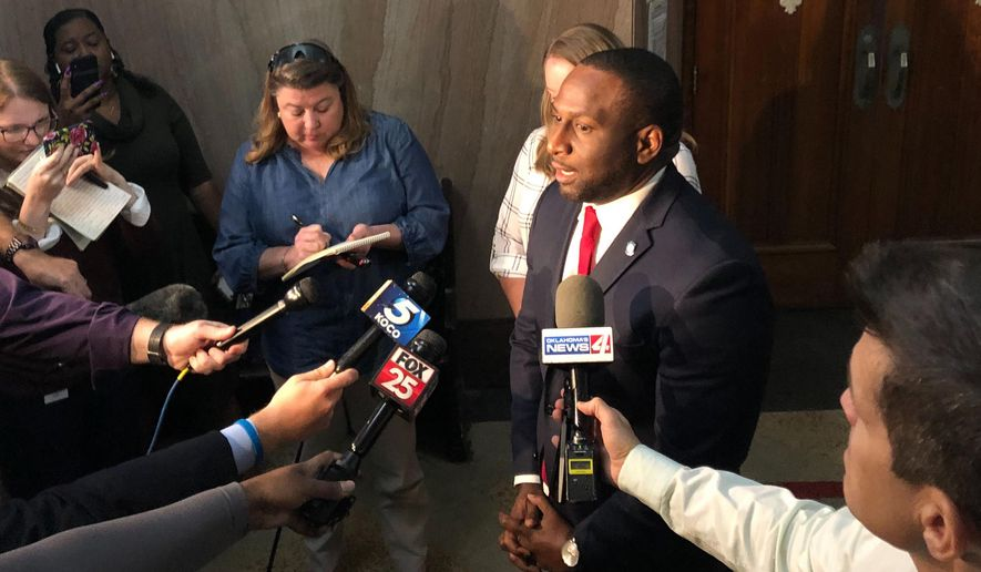 Oklahoma State Rep. Jason Lowe speaks to the media Monday, Oct. 7, 2019 in Oklahoma City after he and other advocates for tighter gun laws filed a lawsuit challenging a new Oklahoma law that will allow people to carry firearms without a background check or training. Lowe filed his lawsuit Monday in Oklahoma county, arguing the law violates a constitutional requirement that bills deal with only one subject matter. (AP Photo/Sean Murphy)