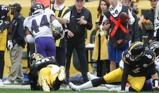 Baltimore Ravens cornerback Marlon Humphrey (44) runs with the ball after recovering a fumble by Pittsburgh Steelers wide receiver JuJu Smith-Schuster (19) during overtime of an NFL football game, Sunday, Oct. 6, 2019, in Pittsburgh. Steelers quarterback Devlin Hodges (6) is at right. (AP Photo/Don Wright)q