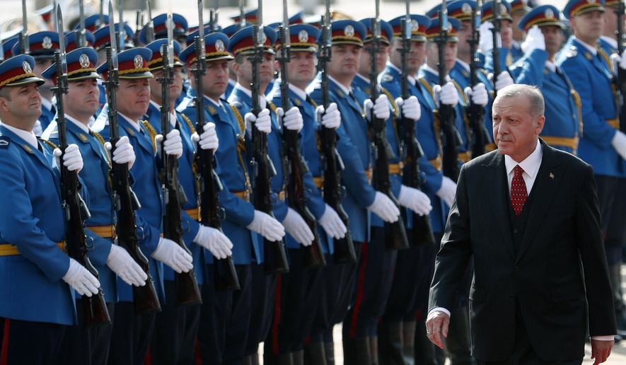 Turkey's President Recep Tayyip Erdogan reviews the honour guard during a welcome ceremony ahead of his meeting with his Serbian counterpart Aleksandar Vucic, in Belgrade, Serbia, Monday, Oct. 7, 2019. Erdogan is on a two-day official visit to Serbia. (AP Photo/Darko Vojinovic)
