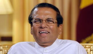 FILE - In this May 7, 2019, file photo, Sri Lankan President Maithripala Sirisena smiles during an interview with the Associated Press at his residence in Colombo, Sri Lanka. Sirisena has opted not to seek a second term, as officials began accepting nominations Monday for next month's election. (AP Photo/Eranga Jayawardena, File)